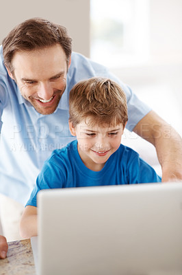 Buy stock photo Portrait of a happy young father and his son using laptop - Indoor