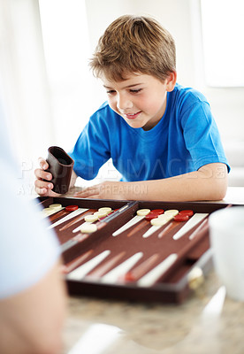 Buy stock photo Portrait of a happy little boy playing backgammon game - Indoor