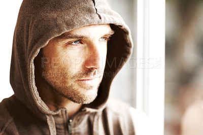 Buy stock photo Portrait of a handsome young man in winter hoodie looking away