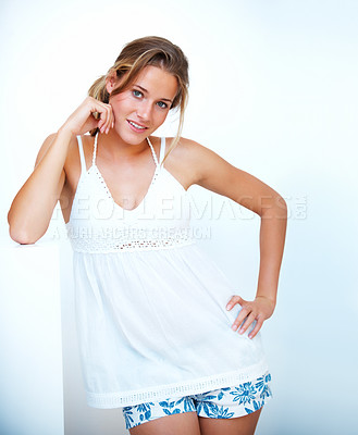Buy stock photo Portrait of a confident young girl posing against white background