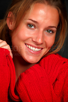 Buy stock photo Closeup portrait of an attractive young woman wearing a red sweater