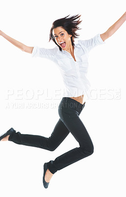Buy stock photo Cute young energetic woman jumping in air against white