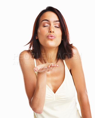 Buy stock photo Cute young female blowing a kiss at you against white background
