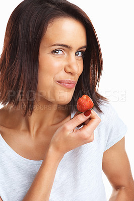Buy stock photo Portrait of a smiling pretty female holding a fresh red strawberry