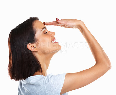 Buy stock photo Profile shot of a young woman with hand to forehead isolated against white background