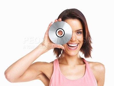 Buy stock photo Portrait of a laughing young girl holding CD on white background