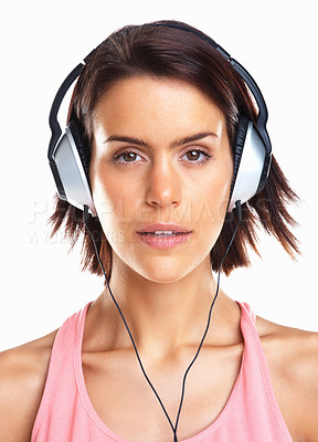 Buy stock photo Closeup of an attractive young woman listening to music against white background