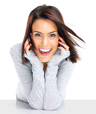 Buy stock photo Closeup portrait of smiling young woman with hands cupped under chin against white background
