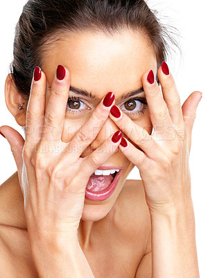 Buy stock photo Closeup portrait of a happy young woman covering her face with her hands against white background