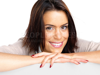 Buy stock photo Portrait of a relaxed young woman smiling against white background
