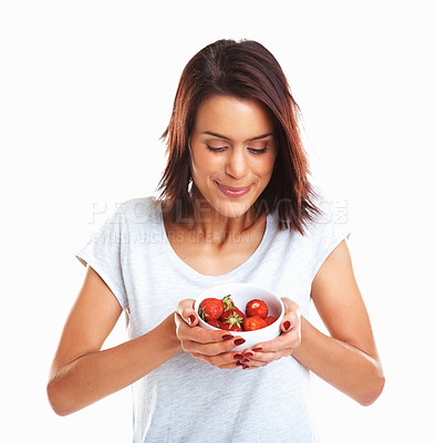 Buy stock photo Yummy! Portrait of a young pretty lady with fresh strawberries in bowl
