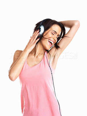 Buy stock photo Portrait of a happy young woman enjoying music against white background