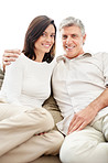 Lovely mature couple relaxing on couch and smiling