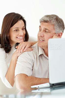 Buy stock photo Portrait of a happy mature couple using internet on laptop