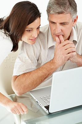 Buy stock photo Portrait of a mature couple using a laptop and thinking