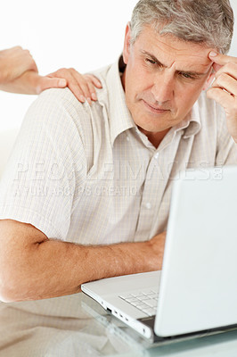 Buy stock photo Portrait of a mature man looking worried while working on laptop