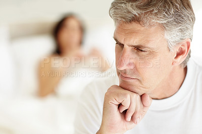 Buy stock photo Closeup of a mature couple having sexual problem wife in the background