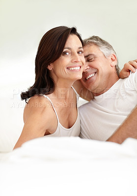 Buy stock photo Portrait of a happy mature female hugging his husband while looking at you