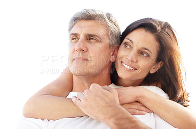 Buy stock photo Portrait of a happy mature couple hugging each other and looking away - Copyspace