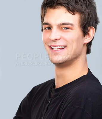Buy stock photo Portrait of a young casual handsome student, laughing.