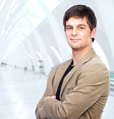 Buy stock photo An attractive business man in a light business setting
