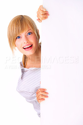 Buy stock photo Surprised woman holding sign - Portrait of a beautiful woman holding a blank billboard.