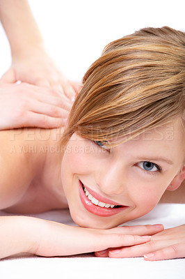 Buy stock photo Young woman lying on massage table at spa, eyes open.