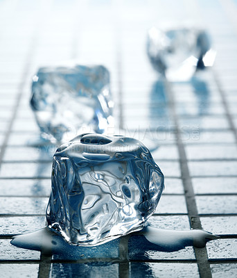 Buy stock photo Simple and clear close-up of single ice cubes on cool colour tiles - differential focus