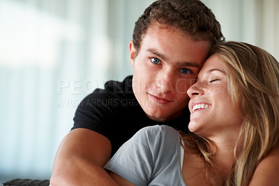 Buy stock photo Closeup portrait of a beautiful young couple having fun together