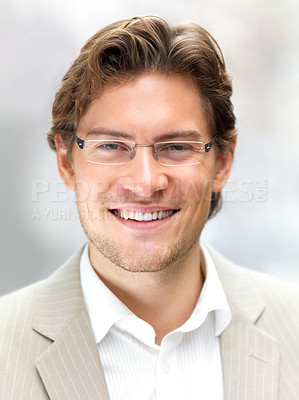 Buy stock photo Closeup of a cheerful young businessman wearing glasses
