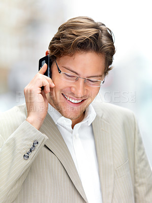 Buy stock photo Young businessman using mobile phone