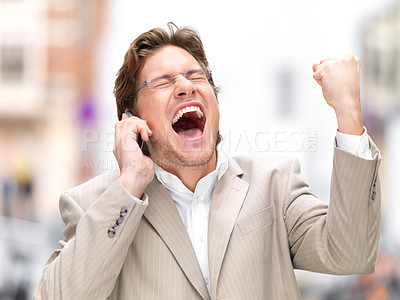 Buy stock photo Successful surprised  businessman with clenched fist using mobile phone. Celebrating some happy news