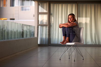 Buy stock photo Portrait of a beautiful young female sitting on the chair at home - Indoor