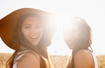 Buy stock photo Two beautiful young friends spending time together in the sunshine