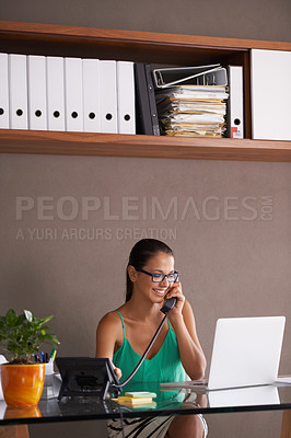 Buy stock photo An attractive businesswoman taking a business call from her desk