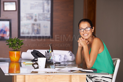 Buy stock photo A beautiful young woman smiling confidently at the camera
