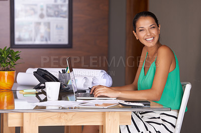 Buy stock photo A young woman smiling happily at the camera