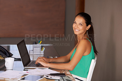 Buy stock photo A beautiful young woman typing a document