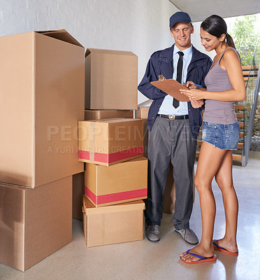 Buy stock photo Full length shot of a gorgeous woman signing a delivery form