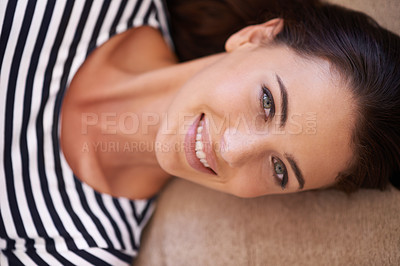 Buy stock photo Portrait of a beautiful young woman relaxing at home