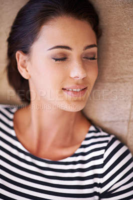 Buy stock photo Shot of an attractive young sleeping on her sofa at home