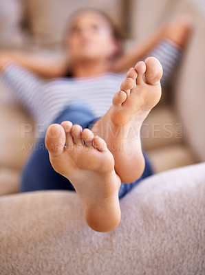 Buy stock photo Shot of a young sleeping on her sofa at home