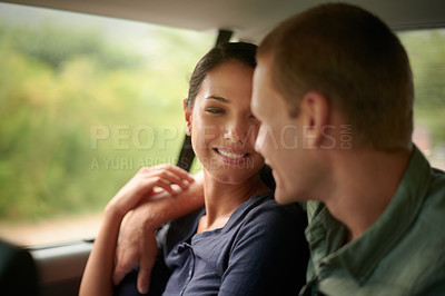 Buy stock photo A portrait of a happy man riding in the back of a car with his beautiful wife