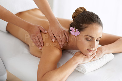 Buy stock photo Cropped shot of a half covered young woman enjoying a massage