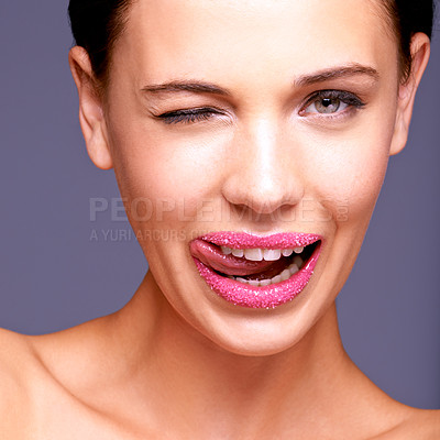 Buy stock photo Cropped shot of a woman licking her lips covered in sugar