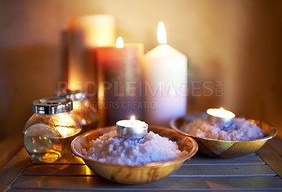 Buy stock photo An arrangement of scented candles, salts and oils at a spa