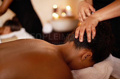 Buy stock photo Shot of young women enjoying relaxing head massages at the day spa