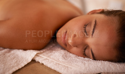 Buy stock photo Closeup shot of a young woman lying on a massage table