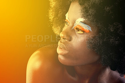 Buy stock photo Studio shot of a beautiful model wearing colorful eye make-up tinted in red light