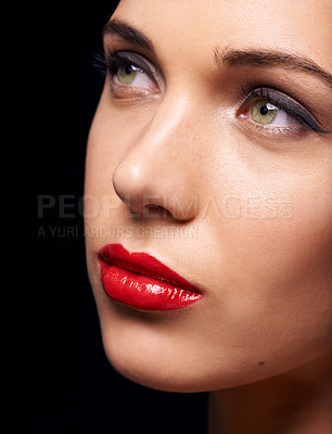Buy stock photo A closeup of a beautiful young woman wearing red lipstick, isolated on black